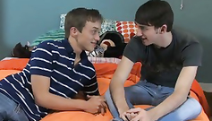 Wonderful young and fresh gay boys are hotly fucking on the bed