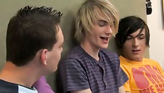 Three nude teen twinks on the bed are sucking each others' dicks
