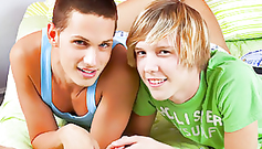 Two hot and pretty young gay boys are lying on the bed