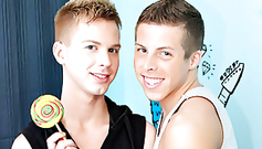 Beautiful young glamour teen gays are posing sexy with candy